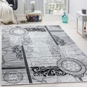 alfombra blanca y negra paco home