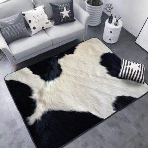 alfombra blanca y negra vaca